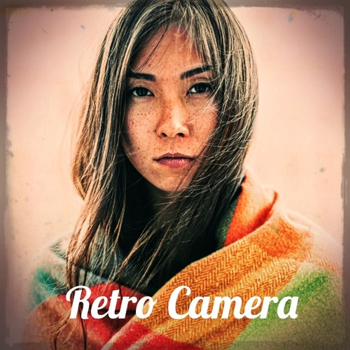 Beautiful woman wrapped in colored blanket looking at camera